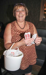 Paul Bickford/NNSL photo Volunteer Evellyn Coleman sells Chase the Ace tickets on Aug. 19 at the Ptarmigan Inn.