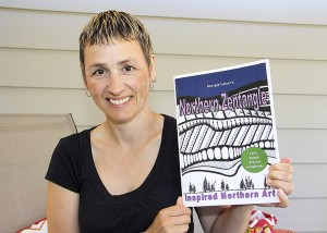 Paul Bickford/NNSL photo Jessica Latour holds a copy of Northern Zentangle, a colouring book featuring Northern images.