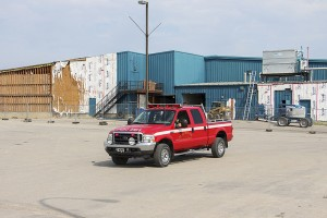 NNSL file photo On July 18, a fire department vehicle drives through the empty parking lot of the NorthMart grocery store. It and several other businesses were closed because of an ammonia leak in the old Don Stewart Recreation Centre being demolished at the time.