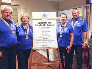 photo courtesy of Paul Delorey A mixed team of curlers from Hay River – left to right, Paul Delorey, Davida Delorey, Judy Goucher and Noel Demarcke – wear the gold medals they won at the Canada 55+ Games in Ontario in mid-August.