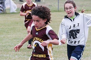 Paul Bickford/NNSL photo Alex Hubert, left, of Ecole Boreale moves the ball while being chased by Olivia Cox of Fort Smith's Joseph Burr Tyrrell School during the Elks Soccer Tournament held Sept. 23 to 25.