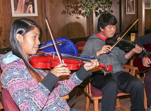 Paul Bickford/NNSL photo Sadee Simba, left, and Maverick Simba, both from Kakisa, were in Hay River on Sept. 29 for a fiddle lesson from Linda Duford. The two young musicians will be back in Hay River on Oct. 8 and 9 for the Thanksgiving long weekend workshop from the Kole Crook Fiddle Association.