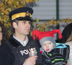 Paul Bickford/NNSL photo RCMP Sgt. Philippe Cyr carries his son Logan at a candlelight vigil on Oct. 6 to remember Const. Christopher Worden, who was killed while on duty in Hay River on Oct. 6, 2007.