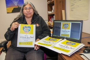 Paul Bickford/NNSL photo Sharon Pekok, the director of recreation with K'atlodeeche First Nation, displays the posters she has been distributing to spread the word about the band's entry into an online competition to seek more funding to build an arena on the Hay River Reserve.