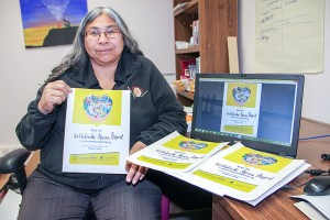 NNSL file photo On Oct. 13, Sharon Pekok, the director of recreation with K'atlodeeche First Nation, displayed the posters she distributed to spread the word about the band's entry into an online competition to seek more funding to build an arena on the Hay River Reserve.