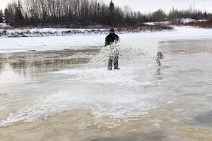 Paul Bickford/NNSL photo On Nov. 18, Joachim Minoza, an employee of K'atlodeeche First Nation, floods the area of the ice crossing between Hay River and the Hay River Reserve.