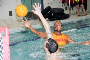 Paul Bickford/NNSL photo Emmanuel Belgrave, a lifeguard at the swimming pool, takes a shot at net during an informal water polo game on Dec. 9, while Kris Rewega plays defence.