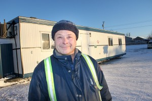Kim Tybring, the lead hand with the recreation department of the Town of Hay River, stands in front of the new warming trailer next to the Ray Benoit Outdoor Rink in 553.