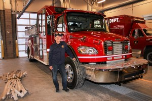 Fire Chief Ross Potter stands next to the new pumper truck at the Hay River Fire Department.