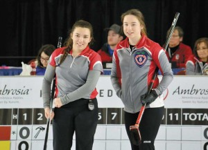 photo courtesy of Curling Canada Julie Squires-Rowe, left, and Zoey Walsh of Hay River watch the action during the Canadian Junior Curling Championships in Victoria, B.C.