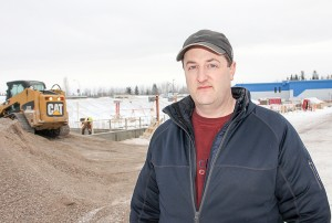 Coun. Jason Coakwell stands just outside the construction site for the new rec centre on Jan. 6.