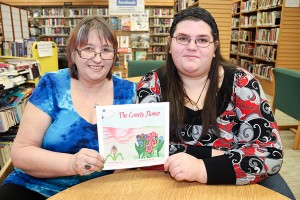 Paul Bickford/NNSL photo A mother and daughter team – illustrator Genevieve Clarke, left, and writer Andrea Clarke – hold their new children's book The Lonely Flower.