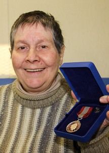 Paul Bickford/NNSL photo Laura Rose displays the Sovereign's Medal for Volunteers that she recently received in the mail.