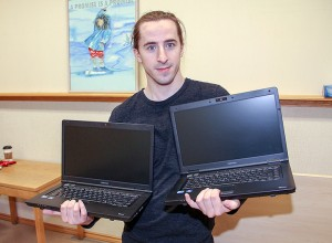 Paul Bickford/NNSL photo Ernest Reid, an assistant librarian at NWT Centennial Library, holds two of the dozen free laptop computers recently obtained from an organization in Yellowknife.
