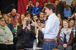 James O'Connor/NNSL photo Hay River Mayor Brad Mapes uses his cell phone to take a photo of Prime Minister Justin Trudeau during a public meeting in Yellowknife on Feb. 10. A delegation from the South Slave, including Fort Smith Mayor Lynn Napier-Buckley, left, delivered an invitation to Trudeau to attend the 2018 Arctic Winter Games during a private meeting.