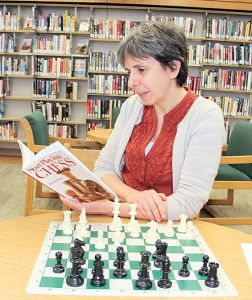 Paul Bickford/NNSL photo Christine Gyapay, the head librarian at NWT Centennial Library, says an upcoming chess tournament is the result of people's interest in the game.